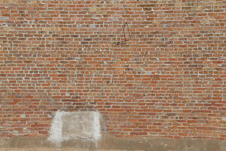 a natural exterior red brick wall facade with sun light