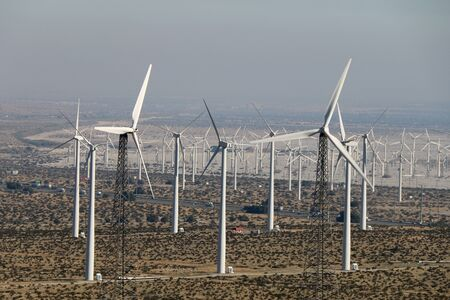 a distance view of a huge wind farm in a western desert