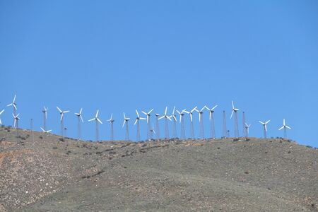 an old retro wind farm on a mountain top distance view