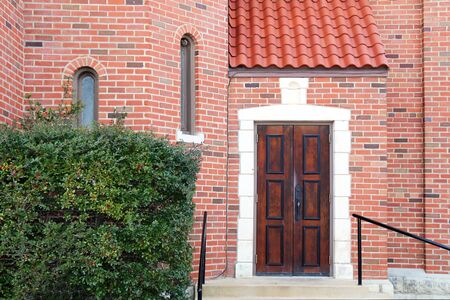 a red brick manor entrance with vintage dark wood door Stock Photo