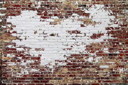 a retro outside garden brick wall painted white and cracked Stock Photo