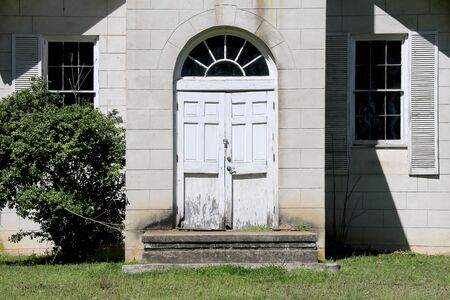 a pair of vintage southern stone abandoned church doors