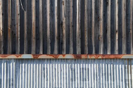 a vintage weathered old metal wood warehouse building Stock Photo