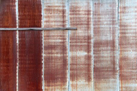 a vintage faced rusted red metal factory warehouse wall Stock Photo