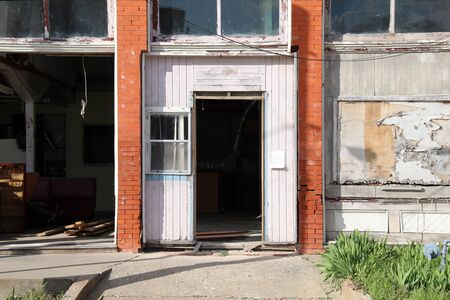 an abandoned deserted old store shop that has been vandalized and damaged then left derelict