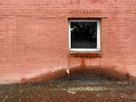 water leaking from window damaged alley brick building 스톡 콘텐츠