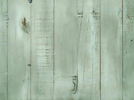 a light green stained wood panel wall fence background
