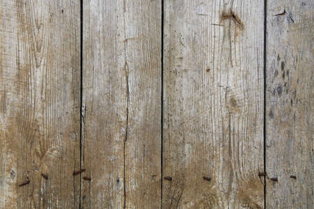 old vintage knotty nails weathered aged wood fence board vertical view suitable for website background marketing backgrounds backdrops architecture architectural layout design