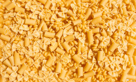 pasta background with random and various styles of macaroni noodles