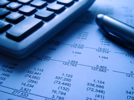 financial statement with calculator and pen 1 Stock Photo