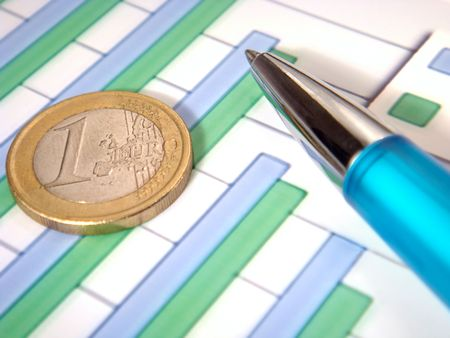bar chart with pen and euro coin