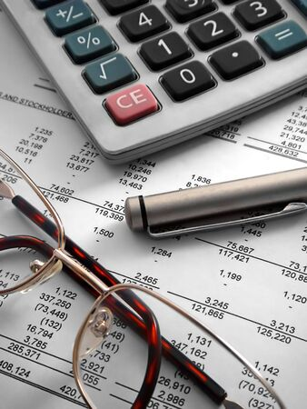 calculator, pen and glasses on financial statement Stock Photo