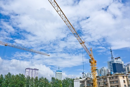 construction crane with skyline and sky in background (4) photo