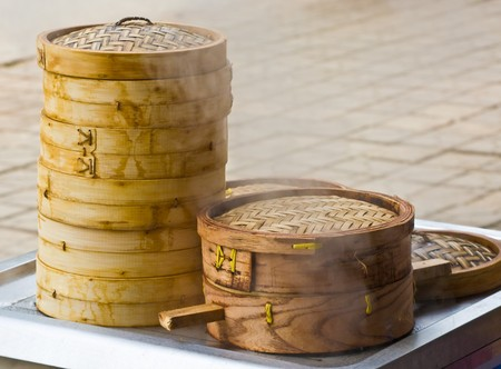 Bamboo dumpling steamer with steam coming out Stock Photo