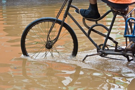 flooded: Bike riding through flooded streets