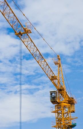 Construction crane with sky in background (1) photo