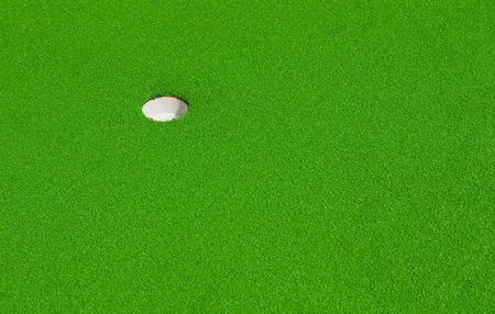 hole on a minigolf course photo