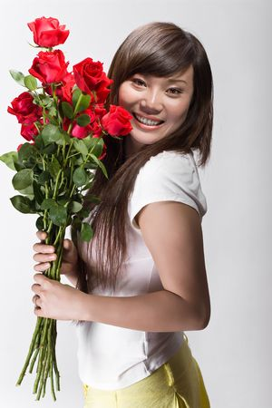 cute chinese girl happy with roses Stock Photo
