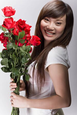 big smile on asian girl with roses photo