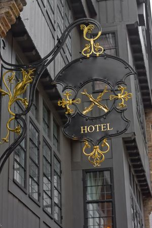 Antique hotel sign template (with golden letters) photo