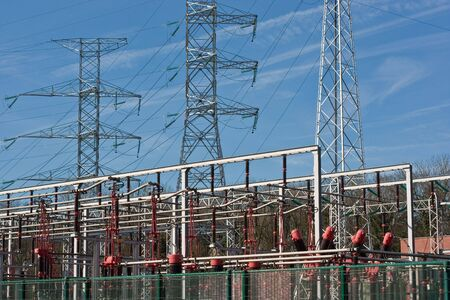 Electrical towers behind battery of transformers in power station