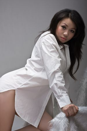 asian girl leaning over chair photo
