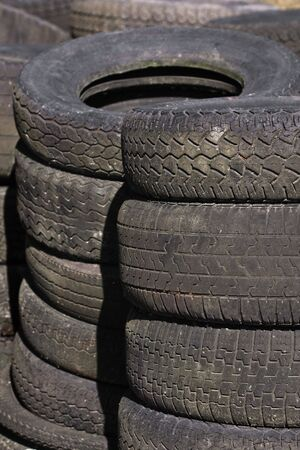 Rows of stacked car tyres (4) photo