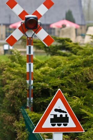 forest railroad: Traffic sign for train crossing road Stock Photo