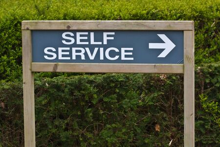 Self service sign with arrow