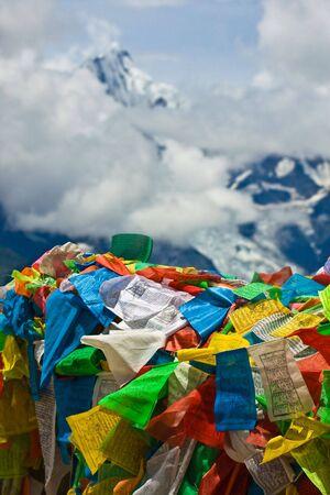 Tibetan prayer flags with meili snow mountain in background photo