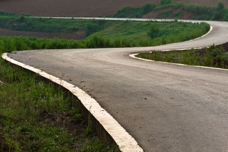 long distance: curved road (depicting the concept of travelling)