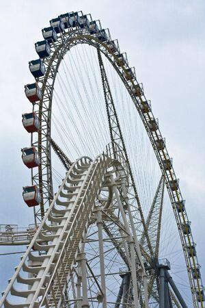 roller coaster in front of ferris wheel on fun fair Stock Photo - 6148665