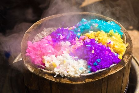 five-coloured glutinous rice in bamboo steamer Stock Photo