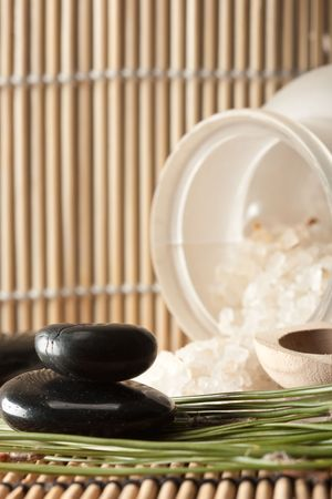 thermotherapy: detail of aromatic salt for spa treatment and basalt stones on bamboo mats (3) Stock Photo