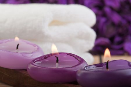 three purple candles and white towel (2) photo