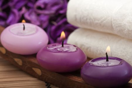 purple candles with white towel in spa setting (2) Stock Photo - 6866414
