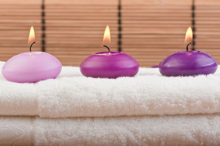 swedish: purple toned candles on white towel and bamboo background (1)