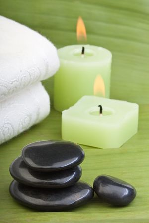volcanic stones: hotstones, candles and towel on banana leaves (2)