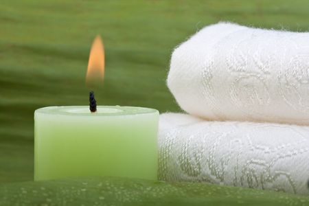 green candle with white towel on green banana leaf Stock Photo - 6866492