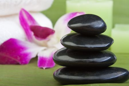 black stones for thermo-therapy with orchids and towel on banana leaves (2) Stock Photo - 6866501