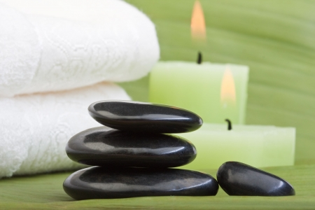 hotstones for thermotherapy with green background (1) photo