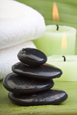 hotstones for thermotherapy with green background (2) Stock Photo