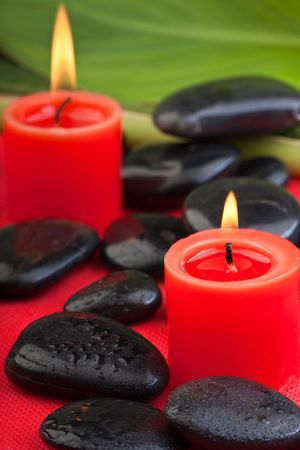 thermotherapy: volcanic hotstones with red candles (2) Stock Photo