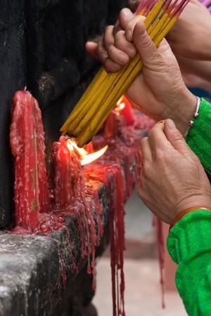 People  lighting incense sticks to commemorate ancestors (2) photo