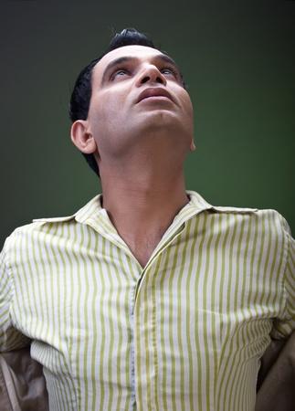 trendy man looking at sky