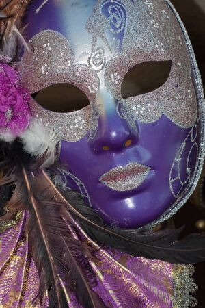 purple and silver venice carnival mask photo