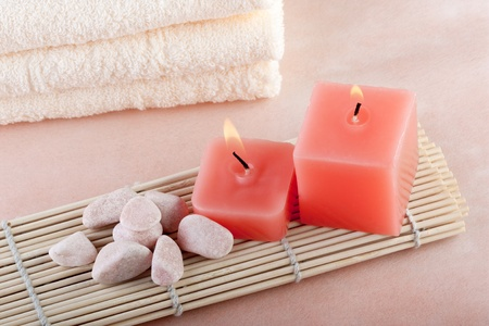 spa candles: red candles on bamboo mat