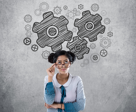 to contemplate: Businesswoman with gear icons Stock Photo