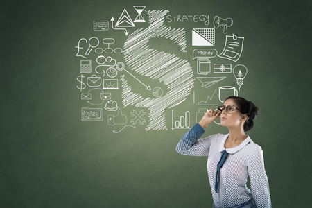 to contemplate: Portrait of businesswoman with business and finance icons Stock Photo