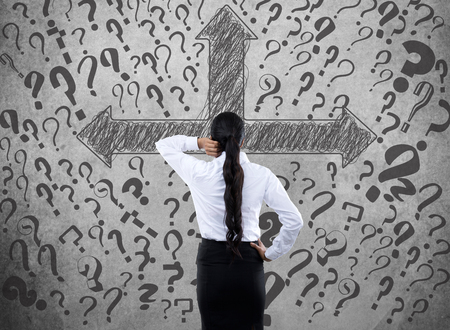 building feature: Confused businesswoman looking for business solution Stock Photo